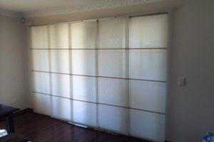 closed panel glides in darkened room