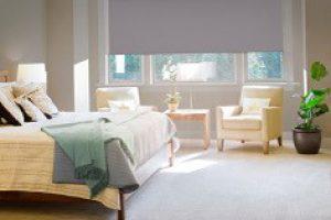 dual rollerblinds in bedroom against window interior