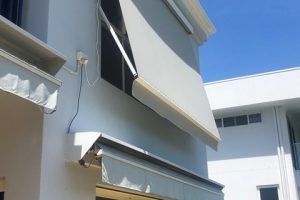 high window cord and reel spring arm awning