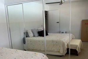 mirror wardrobe door in bedroom
