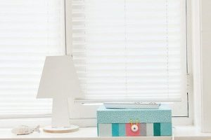 Blinds with pillows in front