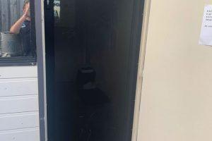punched aluminium door close up