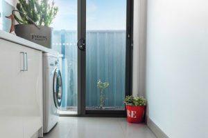 punched aluminium laundry door