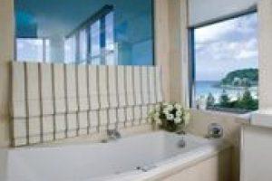 roman blinds open in bathroom