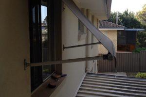 spring arm awning