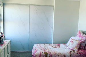 vinyl sliding wardrobe door in bedroom