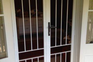 white steel barred door in home