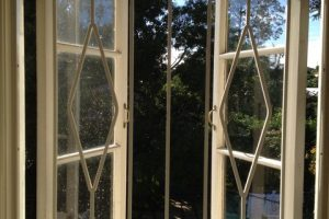white steel barred window