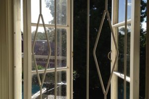 white steel barred window with different angle