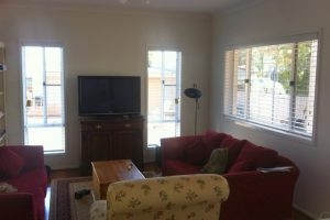 living room lounge with venetian blinds