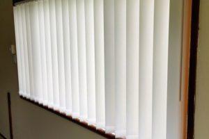 vertical drapes in bedroom