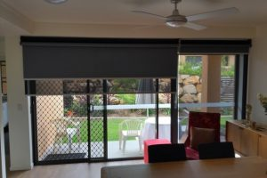 Dual roller blinds on patio