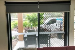 Dual roller blinds over patio entry